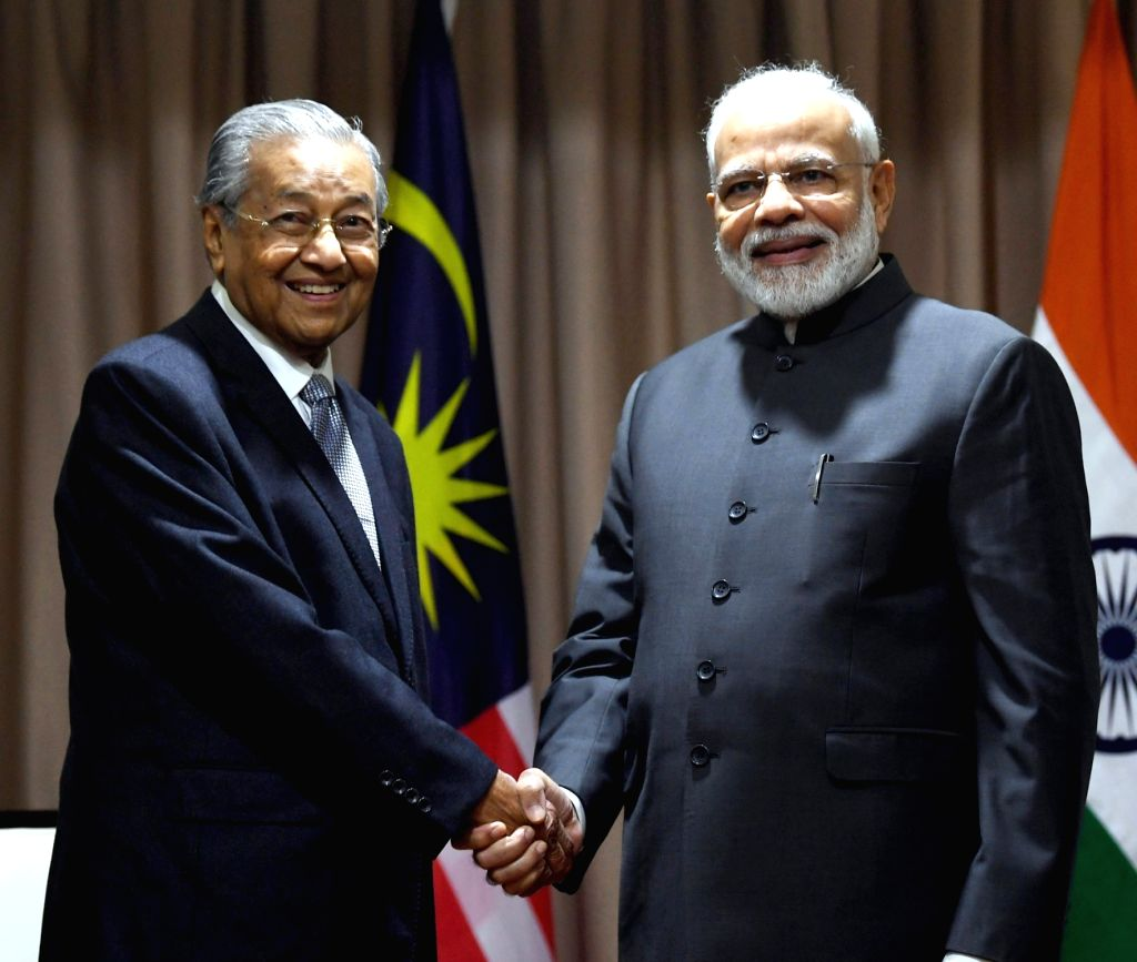 Prime Minister Narendra Modi meets Malaysia Prime Minister Mahathir Mohamad, on the sidelines of 5th Eastern Economic Forum (EEF), at Vladivostok, in Russia on Sep 5, 2019. - Narendra Modi
