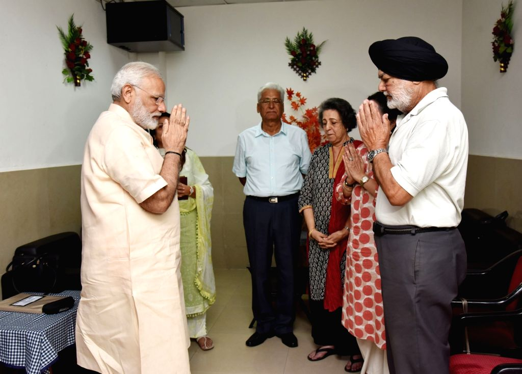Prime Minister Narendra Modi meets Marshal of the Indian Air Force Arjan Singh's family members after visiting Singh who is critically ill following a cardiac attack at Army Hospital ... - Narendra Modi
