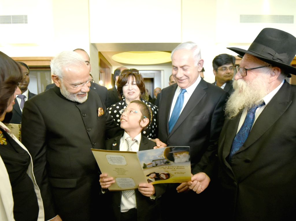 Prime Minister Narendra Modi meets Moshe Holtzberg, the little boy who was orphaned in the 26/11 terror attack on the Chabad House, in Jerusalem, Israel on July 5, 2017. - Narendra Modi