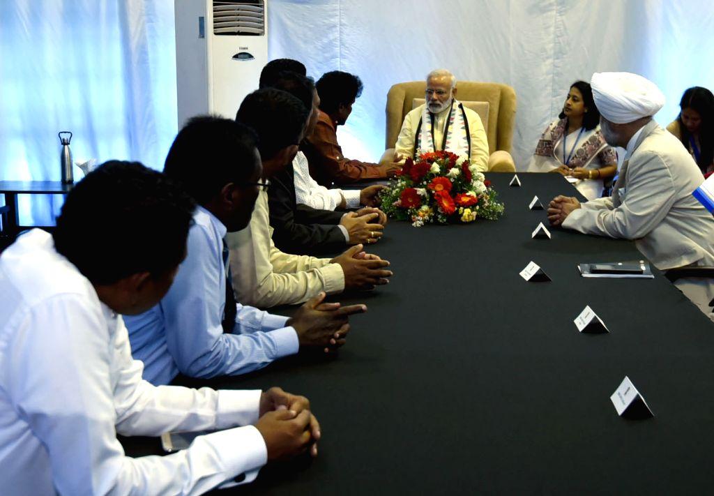 Prime Minister Narendra Modi meets representatives of Tamil Progressive Alliance at Dickoya, in Sri Lanka on May 12, 2017. - Narendra Modi