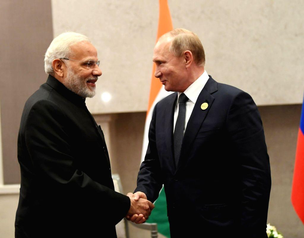 Prime Minister Narendra Modi meets Russia President Vladimir Putin during a bilateral meeting with Russia President Vladimir Putin, on the sidelines of the BRICS Summit, in ... - Narendra Modi