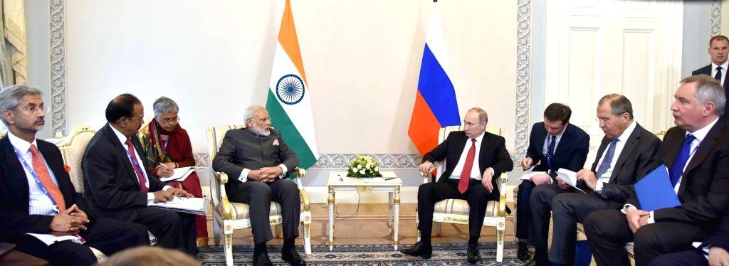 Prime Minister Narendra Modi meets Russian President Vladimir Putin, at Konstantin Palace, in St. Petersburg, Russia on June 1, 2017. - Narendra Modi