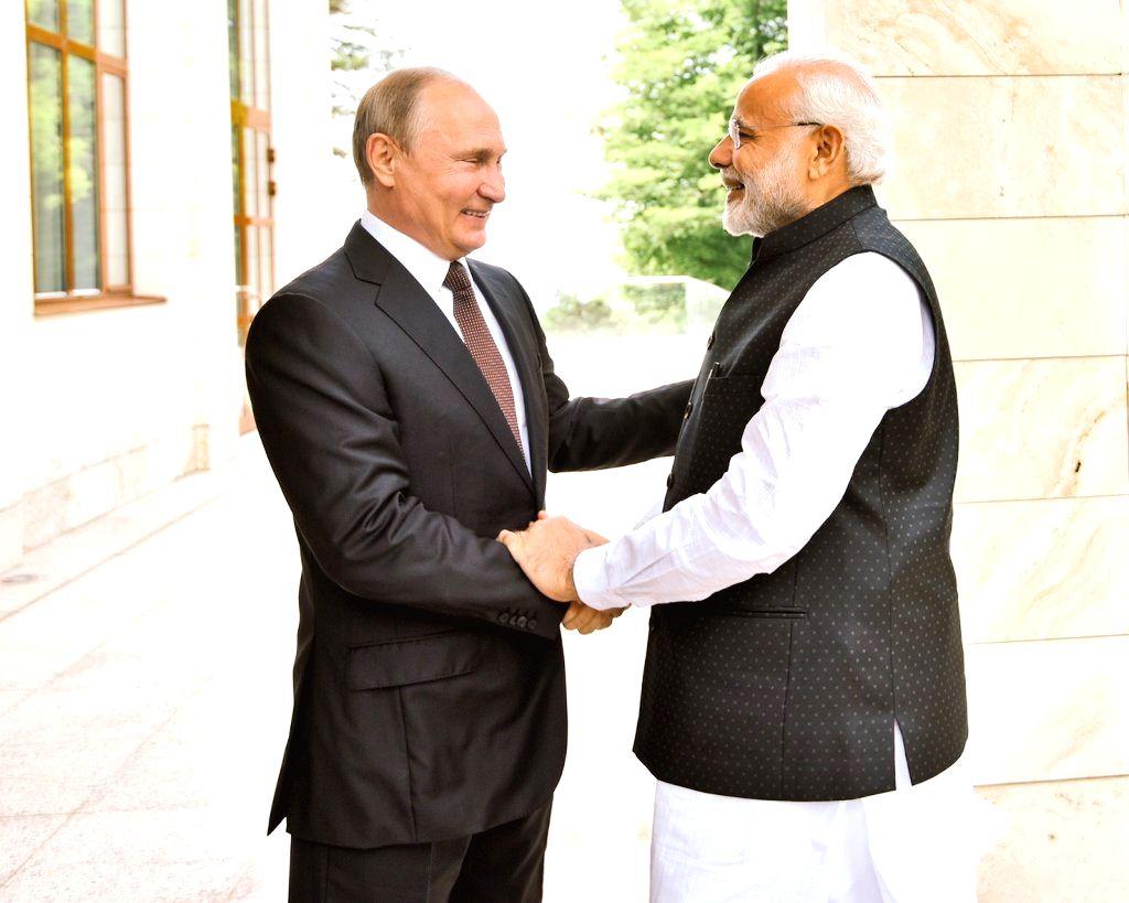 Prime Minister Narendra Modi meets Russian President Vladimir Putin in Sochi, Russia on May 21, 2018. - Narendra Modi