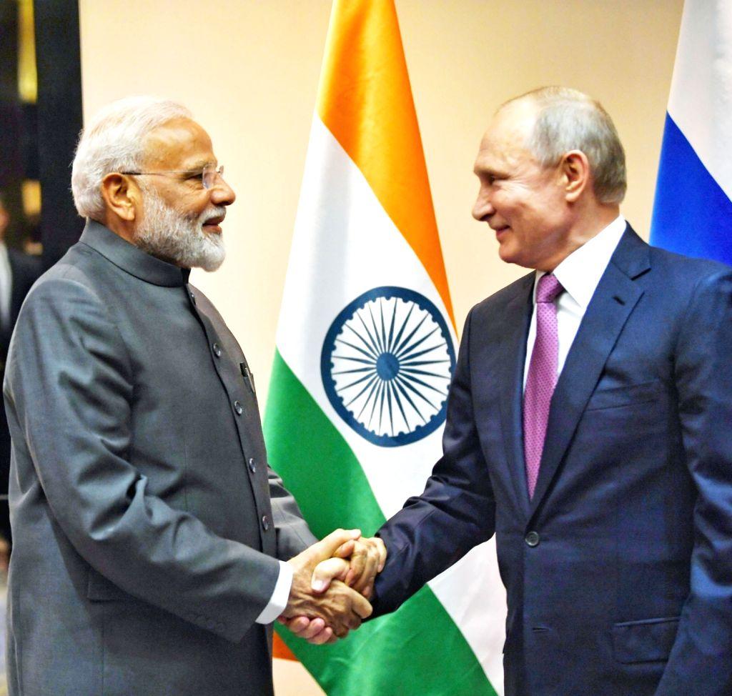 Prime Minister Narendra Modi meets Russian President Vladimir Putin on the sidelines of the SCO Summit in Bishkek, Kyrgyzstan on June 13, 2019. - Narendra Modi