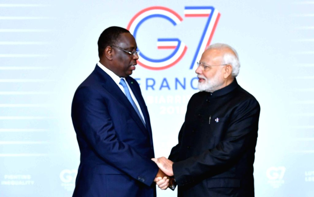 Prime Minister Narendra Modi meets Senegal President Macky Sall on the sidelines of the G7 Summit in Biarritz, France on Aug 26, 2019. - Narendra Modi