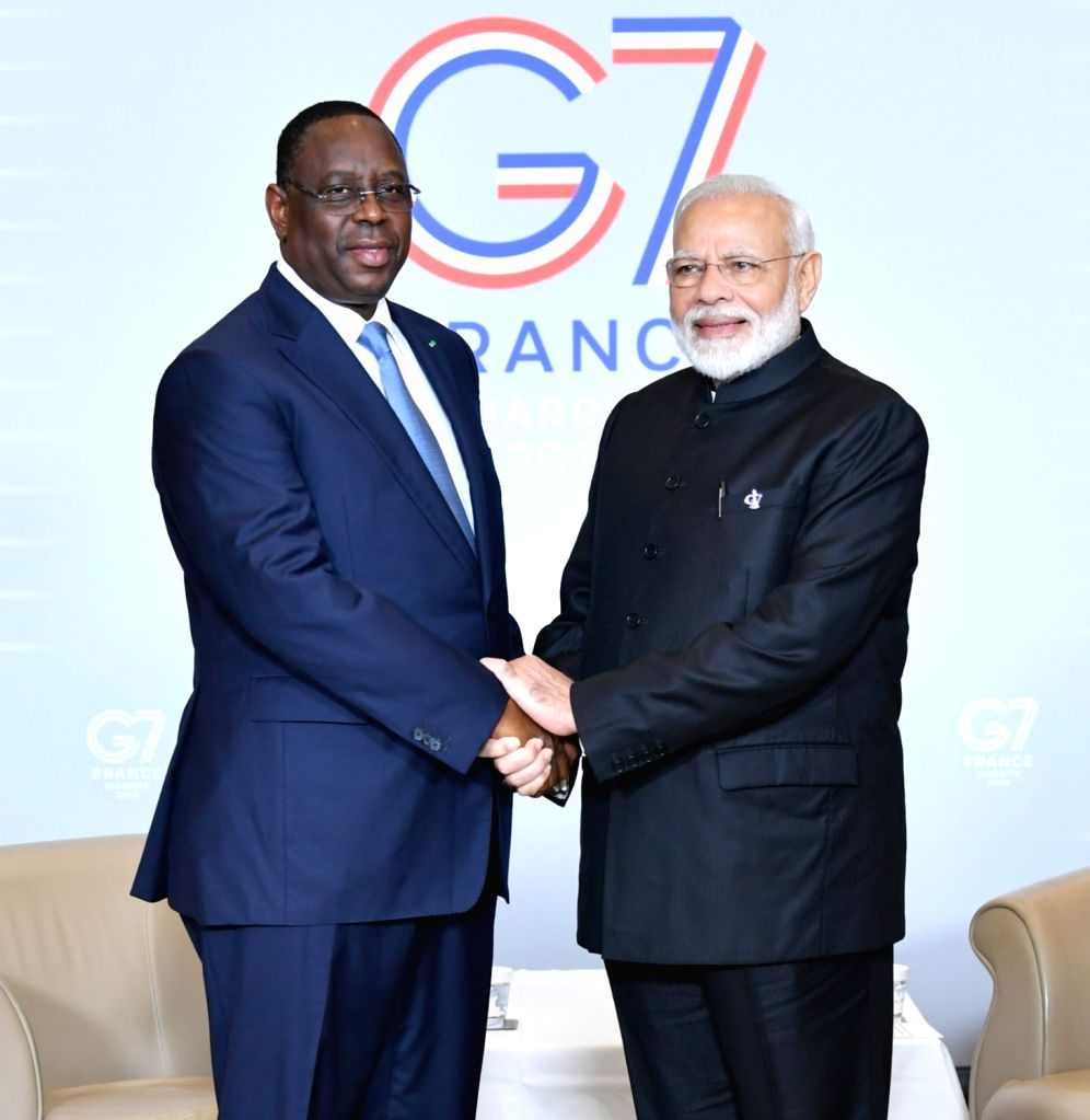 Prime Minister Narendra Modi meets Senegal President Macky Sall on the sidelines of the G7 Summit in Biarritz, France on Aug 25, 2019. - Narendra Modi