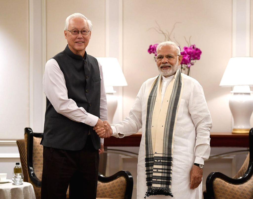 Prime Minister Narendra Modi meets Singapore's Emeritus Senior Minister Goh Chok Tong, in Singapore on June 2, 2018. - Narendra Modi