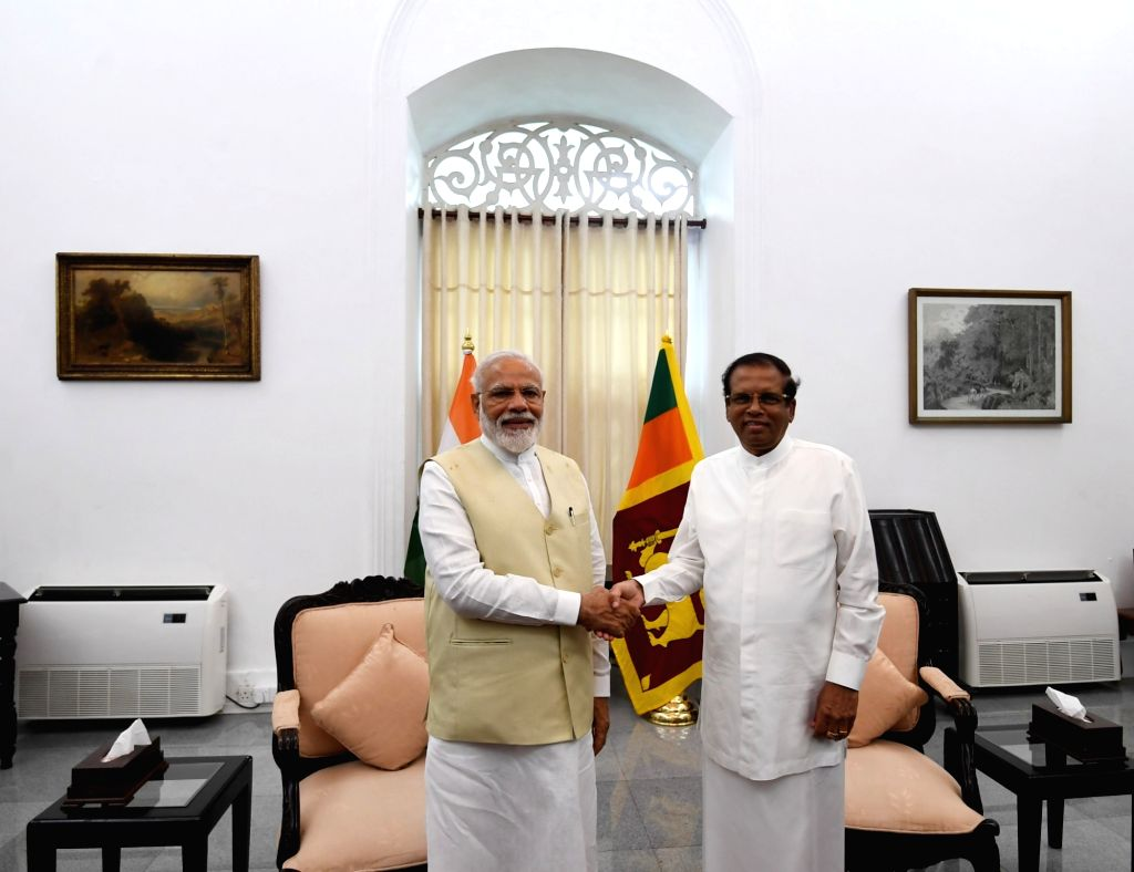 Prime Minister Narendra Modi meets Sri Lanka President Maithripala Sirisena in Colombo, Sri Lanka on June 9, 2019. - Narendra Modi