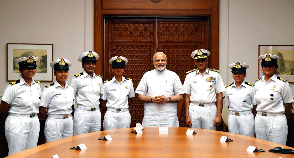 Prime Minister Narendra Modi meets the crew of INSV Tarini which successfully circumnavigated the globe, in New Delhi on May 23, 2018. Also seen Chief of Naval Staff, Admiral Sunil Lanba. ... - Narendra Modi