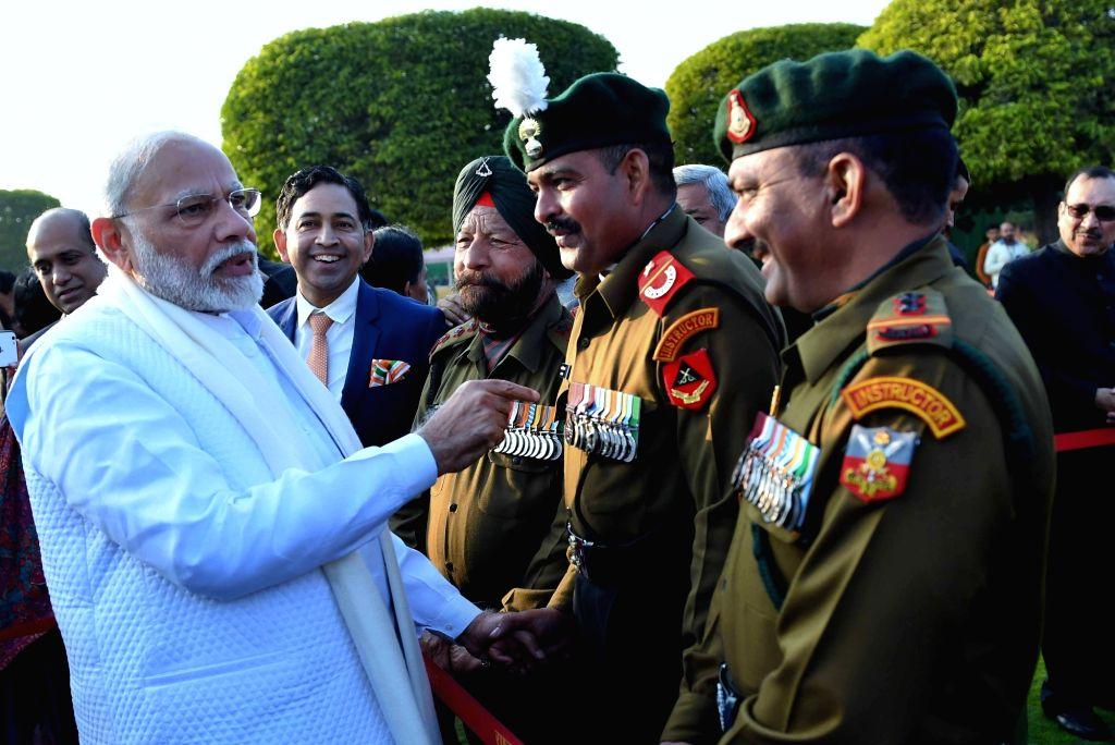 Prime Minister Narendra Modi meets the invitees at the ???At Home Reception??? organised on the occasion of the 71st Republic Day at Rashtrapati Bhavan, in New Delhi on Jan 26, 2020. - Narendra Modi