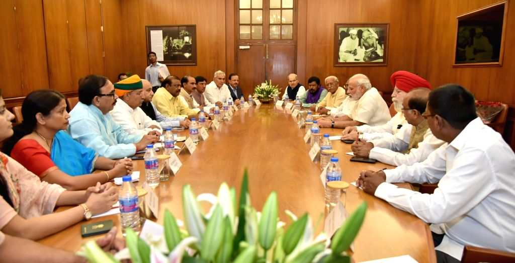 Prime Minister Narendra Modi meets the newly inducted ministers into Union Council of Ministers, in New Delhi on July 5, 2016. - Narendra Modi