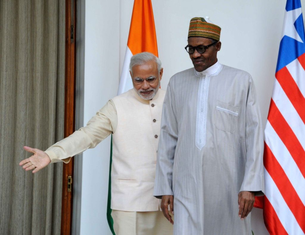 Prime Minister Narendra Modi meets the Nigeria President Muhammadu Buhari during the 3rd India Africa Forum Summit, in New Delhi on Oct 28, 2015. - Narendra Modi
