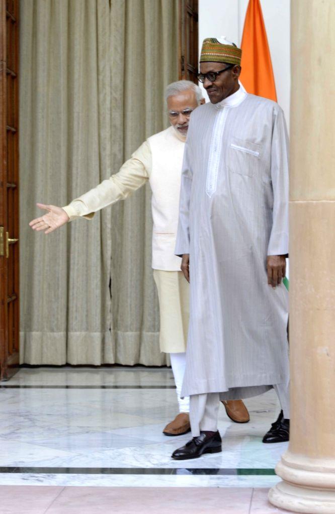 Prime Minister Narendra Modi meets the Nigeria President Muhammadu Buhari during the 3rd India Africa Forum Summit, in New Delhi on Oct 28, 2015. - Narendra Modi