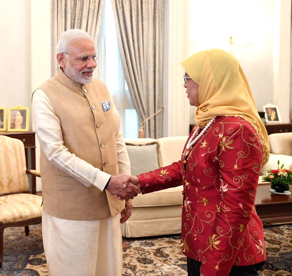 Prime Minister Narendra Modi meets the President of Singapore Halimah Yacob, at Istana - Presidential Palace, in Singapore on June 01, 2018. - Narendra Modi