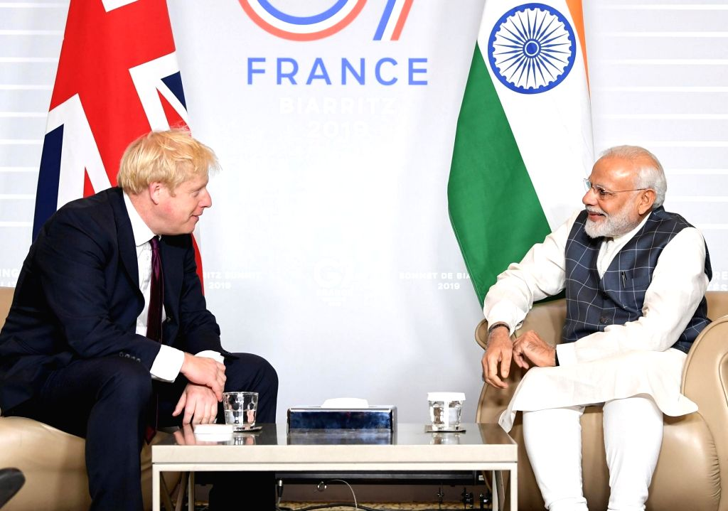 Prime Minister Narendra Modi meets the Prime Minister of the United Kingdom, Boris Johnson on the sidelines of the G7 Summit in Biarritz, France on Aug 25, 2019. - Narendra Modi