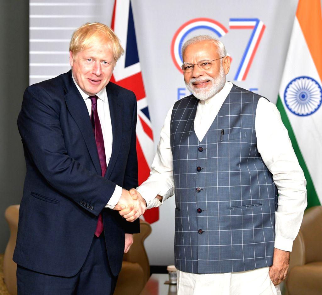 Prime Minister Narendra Modi meets the Prime Minister of the United Kingdom, Boris Johnson on the sidelines of the G7 Summit in Biarritz, France on Aug 25, 2019. - Narendra Modi