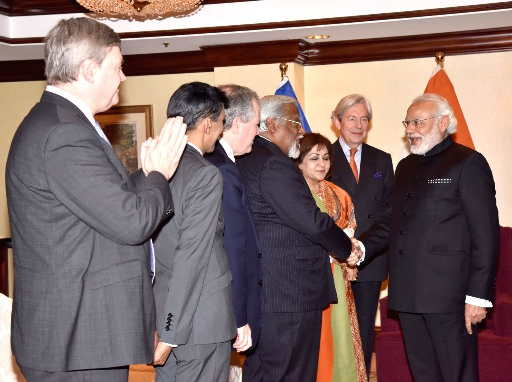 Prime Minister Narendra Modi meets the select members of the European and Belgian Parliaments, in Brussels, Belgium on March 30, 2016. - Narendra Modi