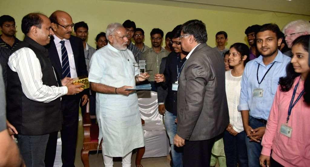 Prime Minister Narendra Modi meets the students of the College of Engineering Pune who created a satellite recently launched by the ISRO, in Pune on June 25, 2016. - Narendra Modi