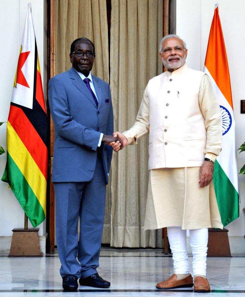 Prime Minister Narendra Modi meets the Zimbabwe President Robert Gabriel Mugabe during the 3rd India Africa Forum Summit, in New Delhi on Oct 28, 2015. - Narendra Modi