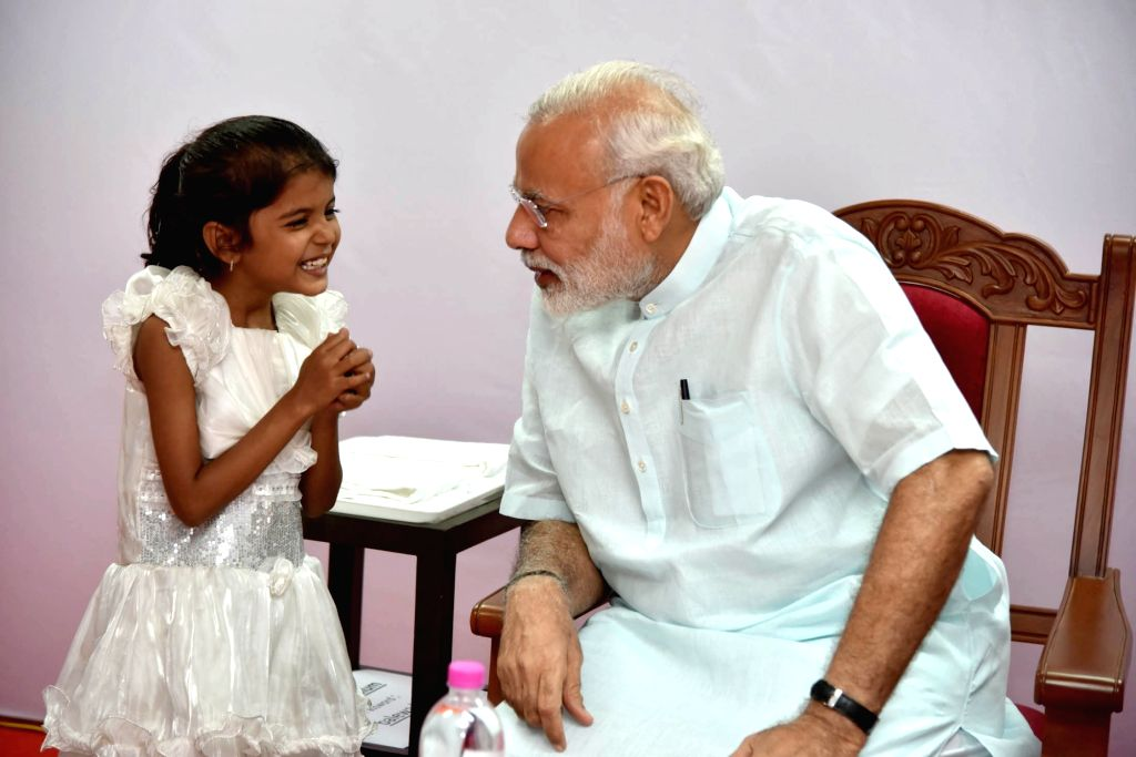 Prime Minister Narendra Modi meets Vaishali whose heart surgery was funded by the PMO India after she wrote to him seeking help, in Pune on June 25, 2016. - Narendra Modi