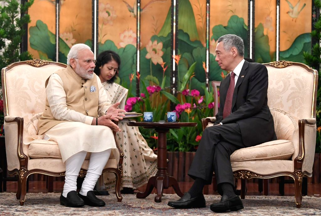 Prime Minister Narendra Modi meets with Singapore's Prime Minister Lee Hsien Loong, at Istana - Presidential Palace, in Singapore on June 01, 2018. - Narendra Modi