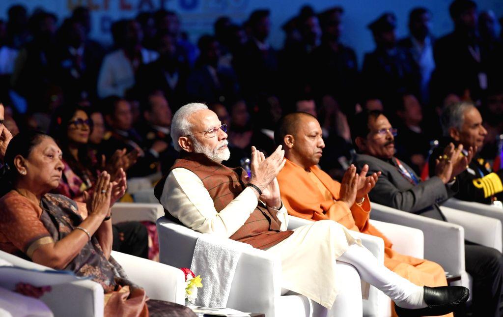 Prime Minister Narendra Modi, MoS Defence Shripad Yesso Naik, Uttar Pradesh Governor Anandiben Patel and Chief Minister Yogi Adityanath, inaugurates the 11th edition of DefExpo2020 in ... - Narendra Modi and Anandiben Patel