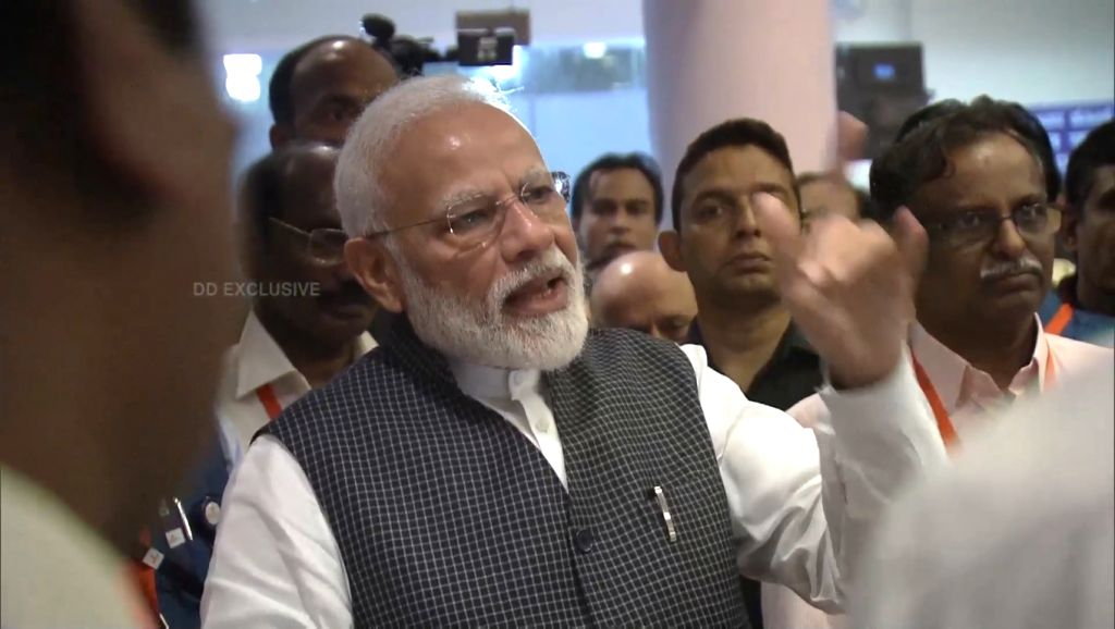 Prime Minister Narendra Modi motivates scientists at ISRO Centre after communication was lost from Vikram  Lander that was scheduled to land on the moon; in Bengaluru on Sep 7, 2019. - Narendra Modi