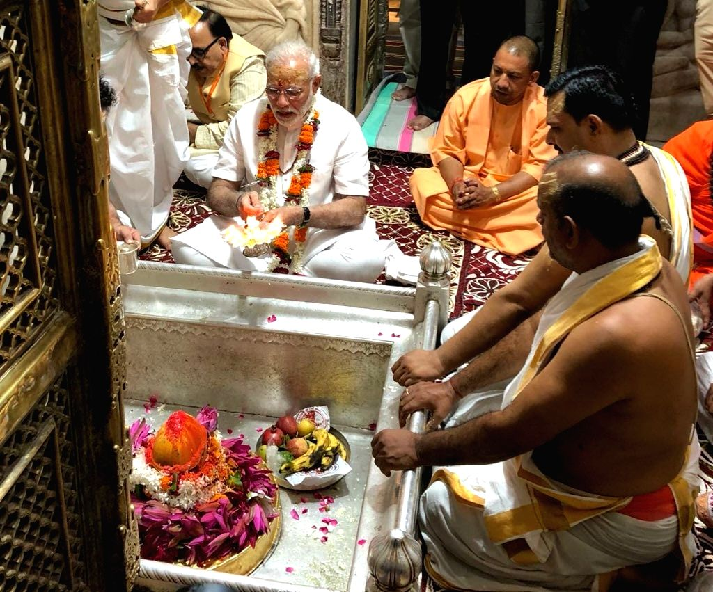 Prime Minister Narendra Modi offers prayers at the Kashi Vishwanath Temple, accompanied by Uttar Pradesh Chief Minister Yogi Adityanath, in Varanasi, on Sept 17, 2018. - Narendra Modi