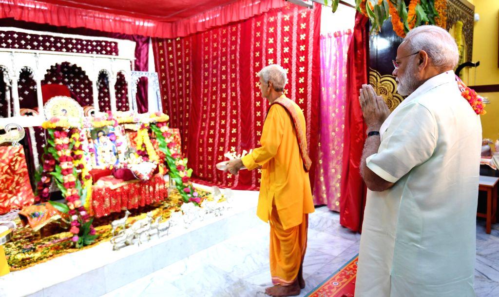 Prime Minister Narendra Modi offers prayers at Shreenathji Temple in Manama, Bahrain on Aug 25, 2019. - Narendra Modi