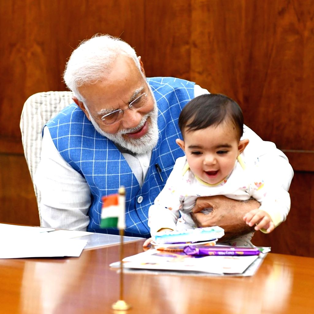 Prime Minister Narendra Modi on Tuesday treated his Instagram followers with pictures of him playing with a toddler in his arms. The picture went viral in seconds and received as many as 13 lakh ... - Narendra Modi