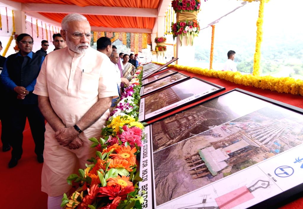 Prime Minister Narendra Modi overviews the construction work of Statue of Unity in Gujarat on Sept 17, 2017. - Narendra Modi