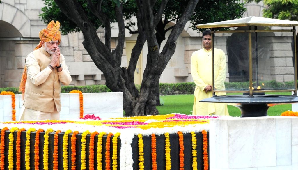 Prime Minister Narendra Modi paying homage at the Samadhi of Mahatma Gandhi, at Rajghat, on the occasion of 69th Independence Day, in Delhi on August 15, 2015. - Narendra Modi