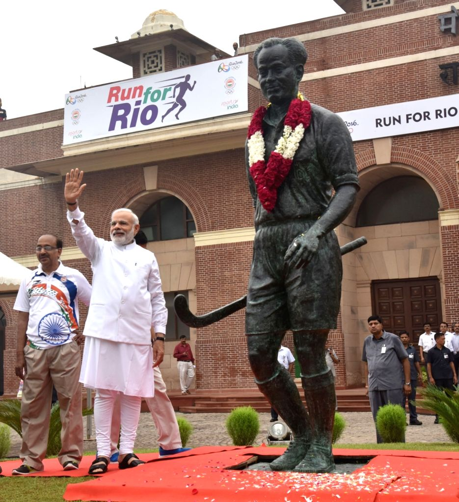 "Prime Minister Narendra Modi paying tributes to Major Dhyan Chand, at the flagging off ceremony of ""Run For Rio"", at Major Dhyan Chand National Stadium, in New Delhi on July 31, ... - Narendra Modi"