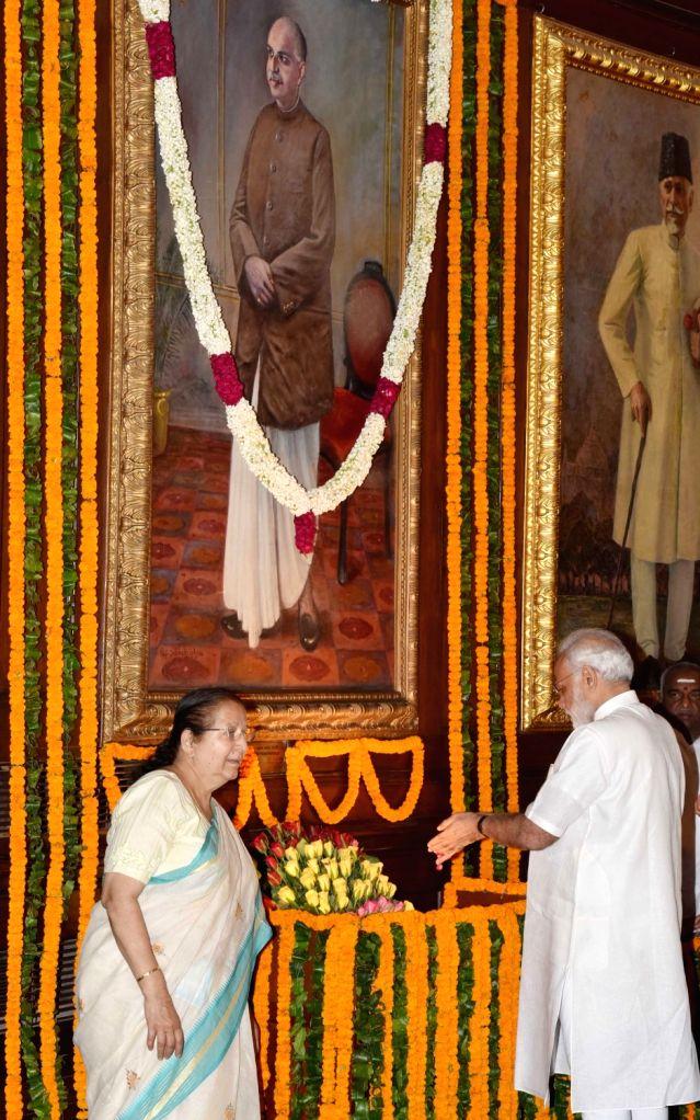 Prime Minister Narendra Modi pays floral tribute to Dr Syama Prasad Mookerjee, on his birth anniversary, at Parliament House, in New Delhi on July 6, 2016. Also seen Speaker of Lok Sabha ... - Narendra Modi and Lok Sabha Mahajan