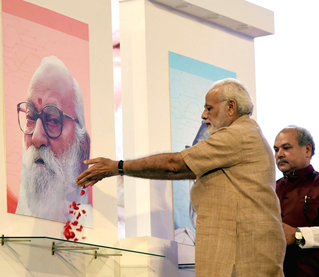 Prime Minister Narendra Modi pays floral tributes to political leader Loknayak Jaiprakash Narayan and Sangh Parivar veteran Nanaji Deshmukh on his birth centenary celebrations at Indian ... - Narendra Modi, Nanaji Deshmukh and Narendra Singh Tomar
