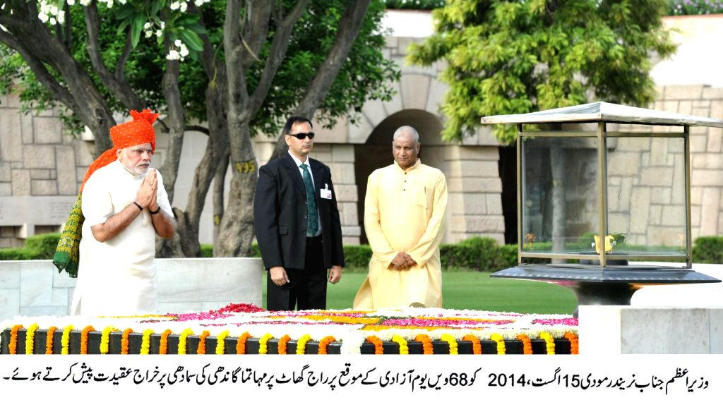 Prime Minister Narendra Modi pays homage at the Samadhi of Mahatma Gandhi, at Rajghat, on 68th Independence Day in Delhi on August 15, 2014. - Narendra Modi
