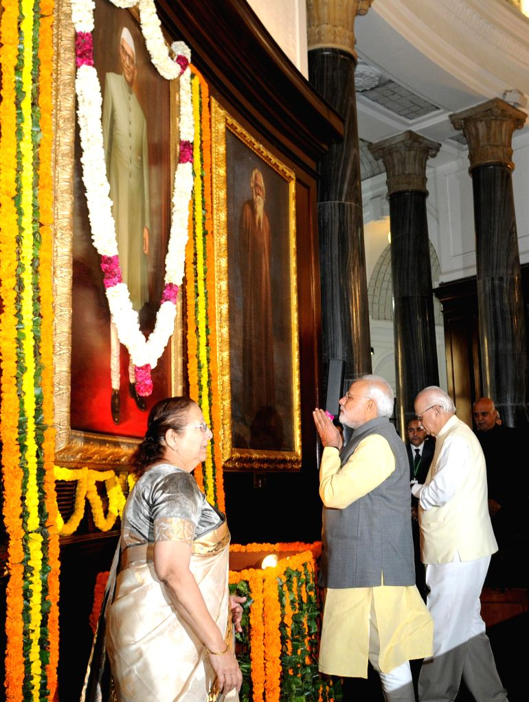 Prime Minister Narendra Modi pays homage to former Prime Minister Morarji Desai, on his birth anniversary, in New Delhi on Feb 28, 2015. Also seen Lok Sabha speaker Sumitra Mahajan and BJP MP from ... - Narendra Modi and Sumitra Mahajan