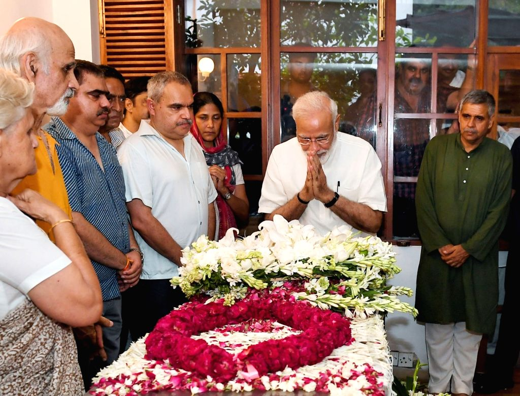 Prime Minister Narendra Modi pays homage to veteran Congress leader and three-time Chief Minister Sheila Dikshit, in New Delhi on July 21, 2019. Dikshit was the Congress President in Delhi ... - Narendra Modi and Sheila Dikshit