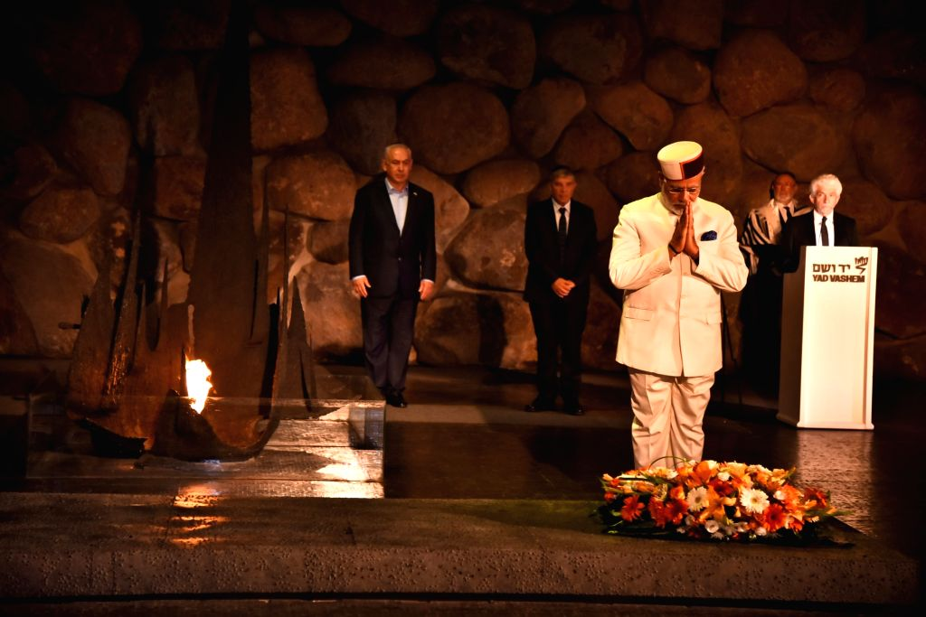 Prime Minister Narendra Modi pays homage to the victims of the Holocaust at Yad Vashem Holocaust Memorial in Jerusalem, Israel on July 4, 2017. Also seen Israeli Prime Minister Benjamin ... - Narendra Modi