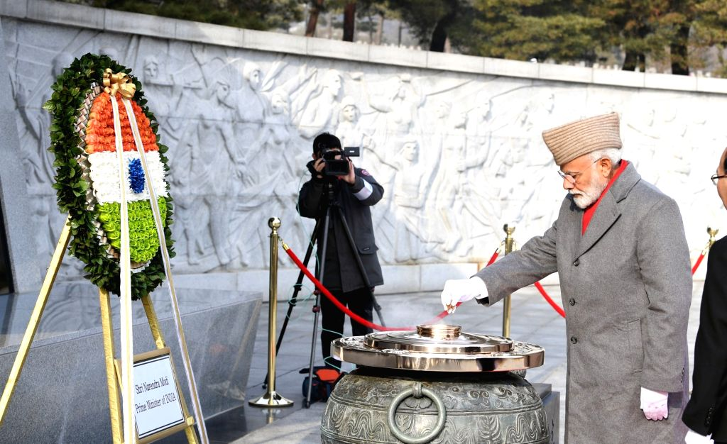 Prime Minister Narendra Modi pays homage to the fallen soldiers at the Seoul National Cemetery, in South Korea's Seoul, on Feb 22, 2019. - Narendra Modi
