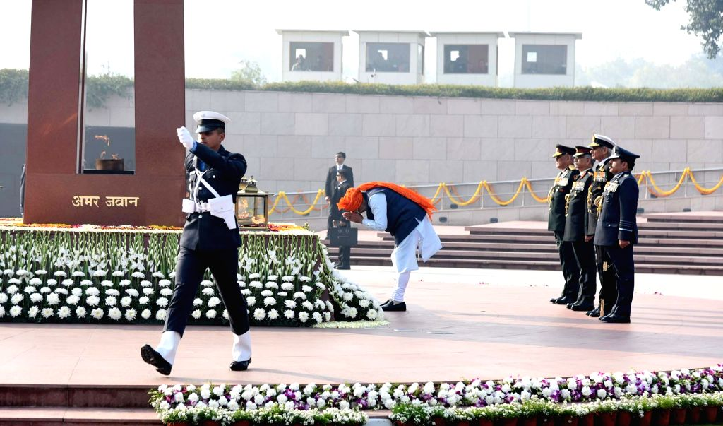 Prime Minister Narendra Modi pays homage to the martyrs at the National War Memorial, on the occasion of the 71st Republic Day, in New Delhi on Jan 26, 2020. - Narendra Modi