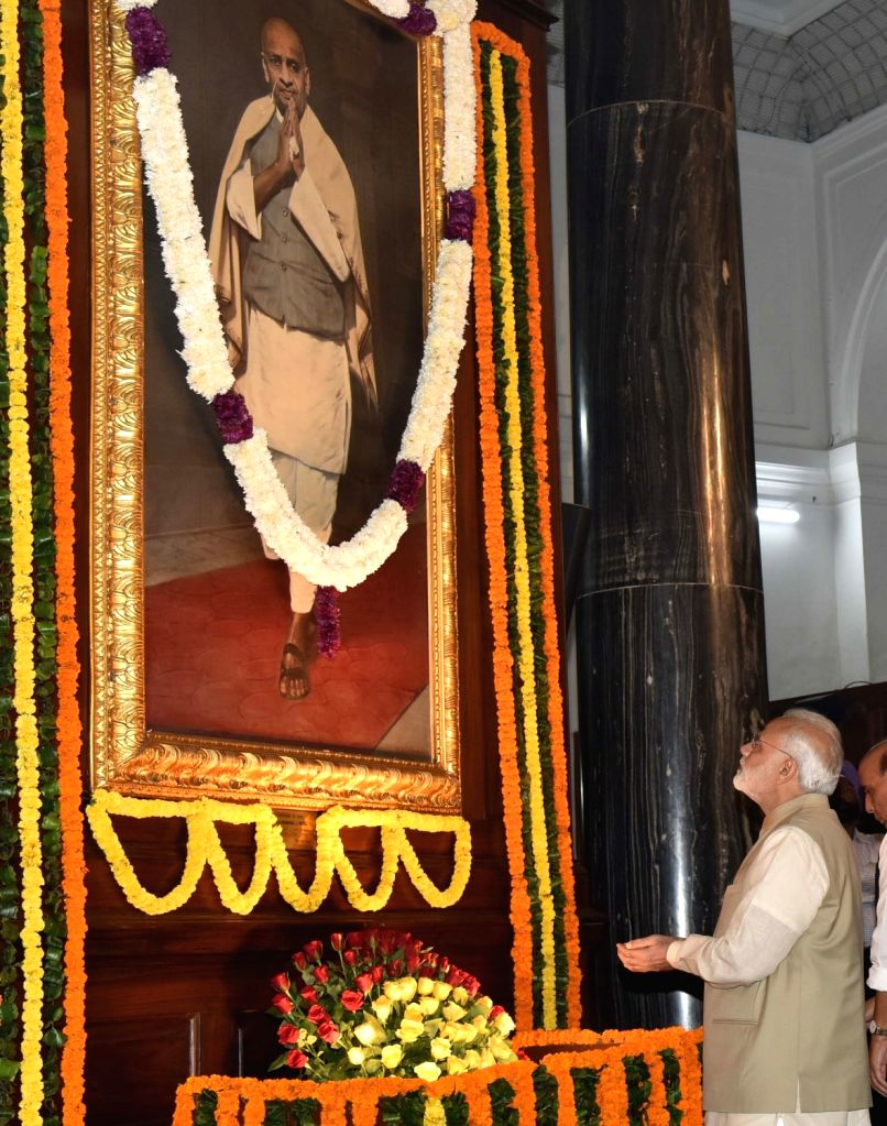 Prime Minister Narendra Modi pays tribute to Sardar Vallabhbhai Patel on his birth anniversary at Parliament House in New Delhi on Oct 31, 2016. - Narendra Modi and Sardar Vallabhbhai Patel