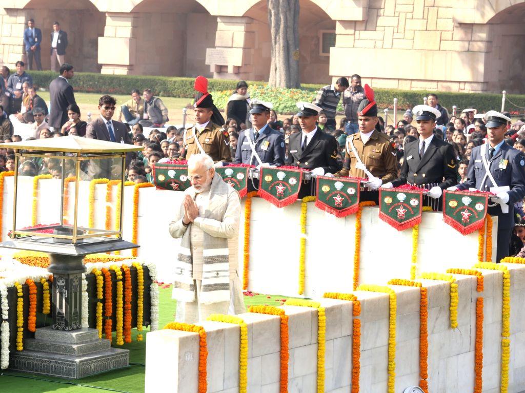 Prime Minister Narendra Modi pays tribute to Mahatma Gandhi on his death anniversary in Rajghat, New Delhi on Jan. 30, 2018. - Narendra Modi