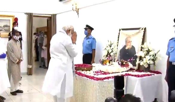 Prime Minister Narendra Modi pays tributes to Former President Pranab Mukherjee at his 10 Rajaji Marg residence in New Delhi on Sep 1, 2020. Mukherjee passed away on Monday evening at ... - Narendra Modi and Pranab Mukherjee