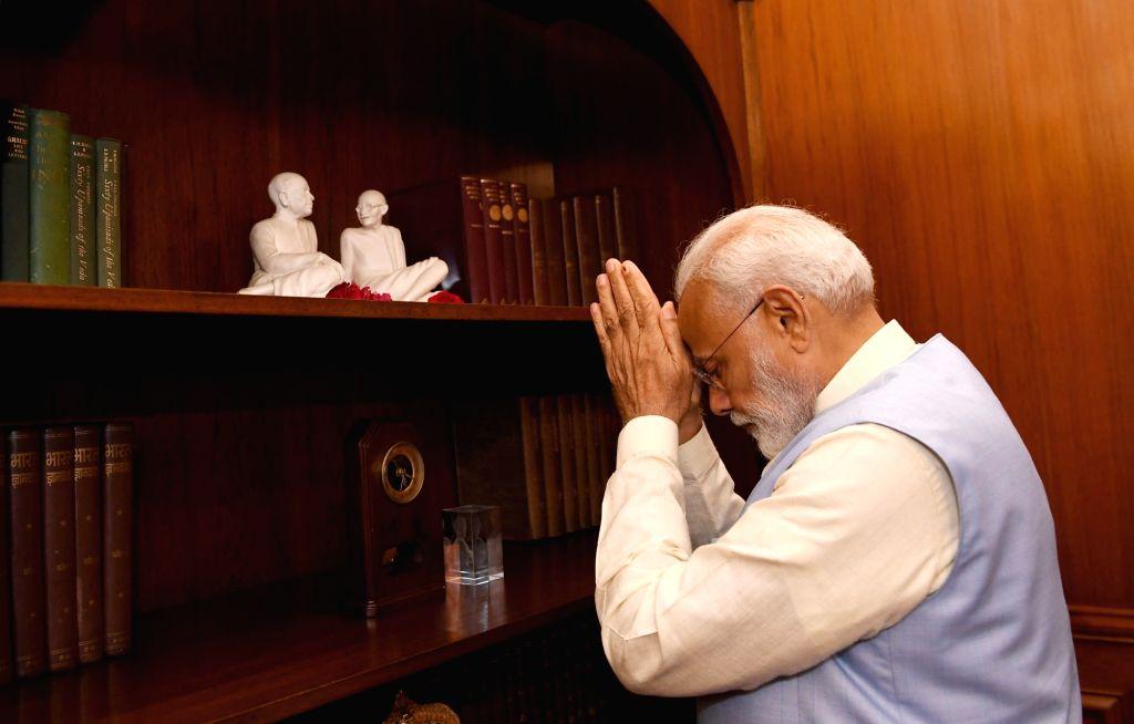 Prime Minister Narendra Modi pays tributes to Mahatma Gandhi and Sardar Patel at the Prime Minister's Office in South Block, in New Delhi on May 31, 2019. - Narendra Modi and Sardar Patel