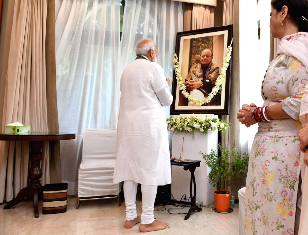 Prime Minister Narendra Modi pays tributes to the former Union Minister Arun Jaitley, at his residence, in New Delhi on August 27, 2019. - Narendra Modi and Arun Jaitley