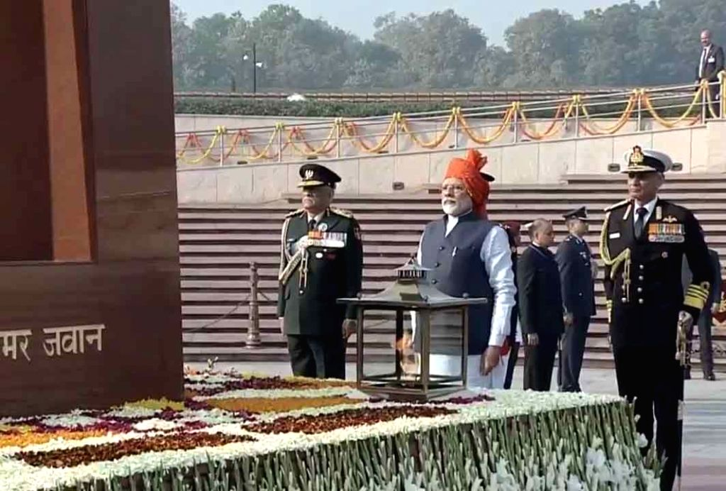 Prime Minister Narendra Modi pays tributes to the martyred soldiers at National War Memorial on the occasion of India's 71st Republic Day, in New Delhi on Jan 26, 2020. Also seen Chief of ... - Narendra Modi