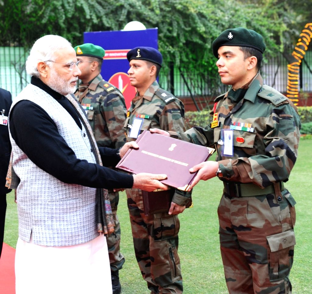 Prime Minister Narendra Modi presents certificates to innovators in the Indian Army, on the occasion of 68th Army Day, in New Delhi on Jan 15, 2016. - Narendra Modi