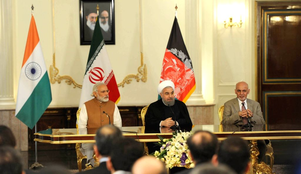 Prime Minister Narendra Modi, President of Iran Hassan Rouhani and the President of Afghanistan, Dr. Mohammad Ashraf Ghani, witness the signing of trilateral agreements between India, ... - Narendra Modi and Hassan Rouhani