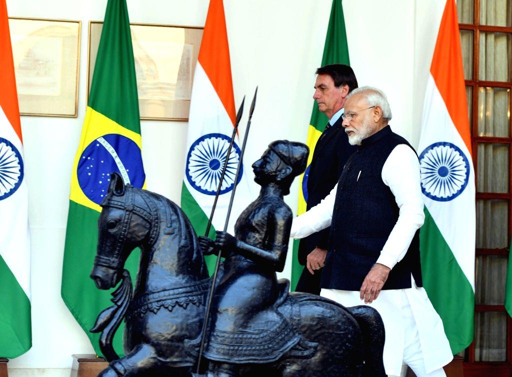 Prime Minister Narendra Modi receives Brazilian President Jair Bolsonaro at Hyderabad House ahead of their delegation-level talks, in New Delhi on Jan 25, 2020. - Narendra Modi